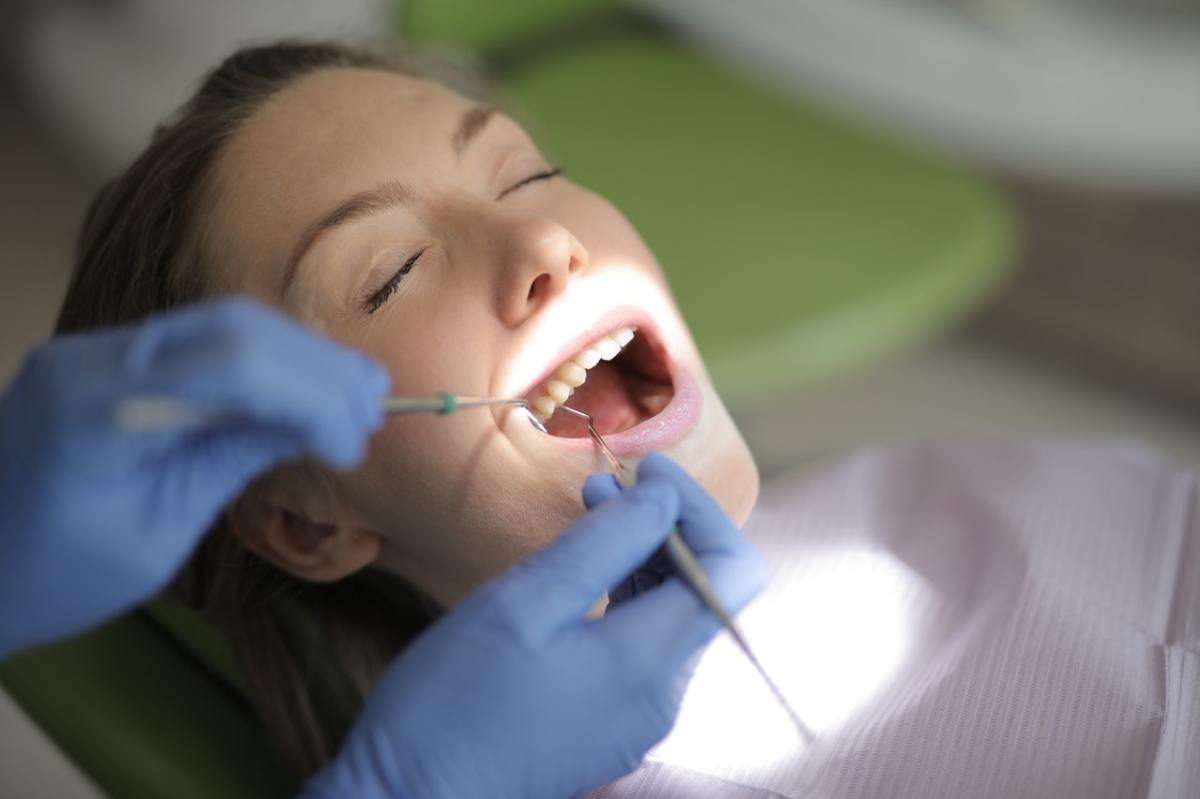 Photograph of a woman at the dentist.