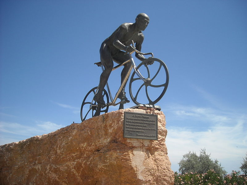 photograph of memorial to cyclist Marco Pantani. Bronze, showing him riding a bike.
