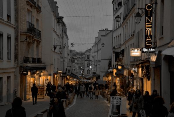 A photo of La Mouffe street market, in Paris, at dusk