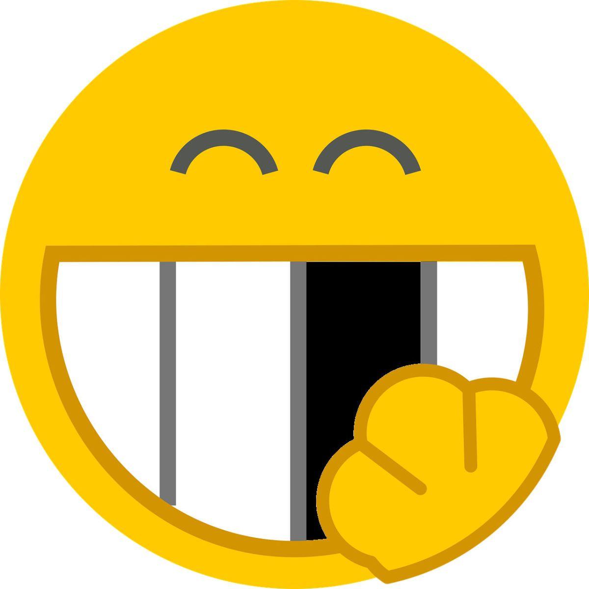 A n image of a smiling emoji. One of its teeth is missing.