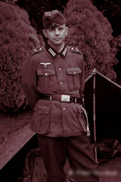 Photo of a man, during a WWII reenactment, dressed as a German soldier